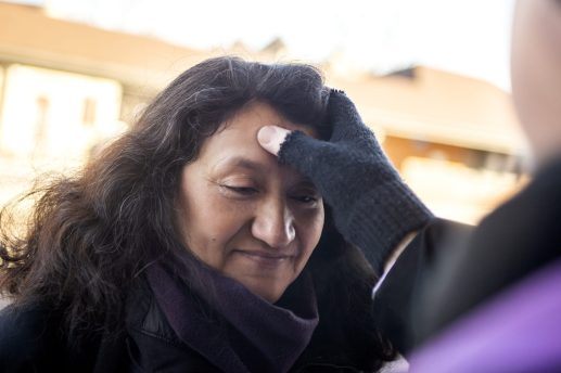 """Ann Minakovic, of Riverside, receives ashes on her forehead on Ash Wednesday, March 6, during Riverside Presbyterian Church and Ascension Lutheran Church's """"Ashes to Go"""" to mark the beginning of Lent at the Riverside train station.   ALEXA ROGALS/Staff Photographer"""