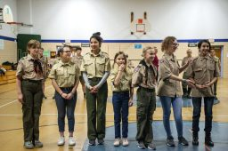 From left, Ellie Knott, 11, McKenzie Monahan, 16, Joanna Vera, 16, Laura Geisert, 11, Ella Tamburello, 11, Kailey Fouts, 14, and Elaina Markus, 12, all of Troop 90GT's Lunar Patrol stand together on Feb. 27, during an induction ceremony for the Boy Scouts of America Troop 90GT at Brook Park Elementary School in La Grange Park. | ALEXA ROGALS/Staff Photographer