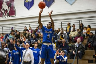 RBHS senior Reggie Loury, a second-team All-Star, takes a jump shot against Lincoln Park in the Class 4A state playoffs. (Alexa Rogals/Staff Photographer)