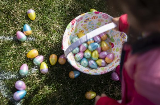 Kids fills their baskets with Easter eggs during the Riverside Parks and Rec's annual Easter Egg Hunt at Big Ball Park on April 13. | Alexa Rogals/Staff Photographer