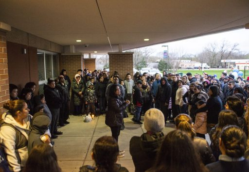 Community members gather to remember the student who died from a self inflicted gunshot on April 18, during a community prayer outside of the front entrance of George Washington Middle School. | ALEXA ROGALS/Staff Photographer