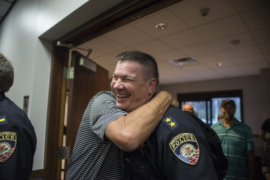 Attendees congratulate Brookfield's new plice chief Ed Petrak on April 22, during a village board meeting at Brookfield Village Hall. | ALEXA ROGALS/Staff Photographer
