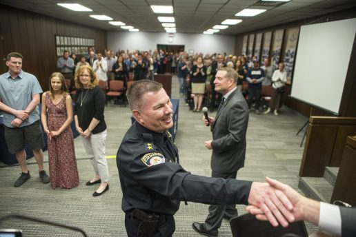 Ed Petrak, Brookfield's new police chief, shakes hands with village trustees after his April 22 appointment. | Alexa Rogals/Staff Photographer