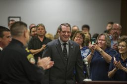 Outgoing Brookfield police chief Jim Episcopo walks up to the front to speak on April 22, during a village board meeting at Brookfield Village Hall. | ALEXA ROGALS/Staff Photographer