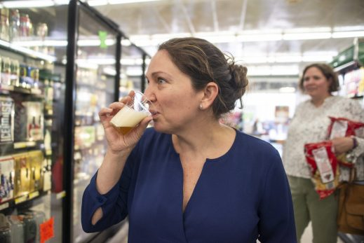 Val Drenth, of Riverside, tries a sample of BuckleDown Brewery's Lush by Design ale at a tasting event at Riverside Foods on April 26. (Alexa Rogals | Staff)