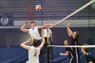 RBHS senior Colby Campbell goes for a kill against Oak Park and River Forest in a nonconference match on April 25. OPRF won 25-23, 19-25, 25-20. (Carol Dunning/Contributing Photographer)