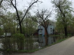 Flood water surrounds a home in the 3800 block of Gladstone Avenue in Riverside Lawn. (Bob Uphues | Staff)