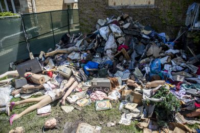 Mannequins, clothing and more is seen scattered in the front yard of the home after a weekend fire on May 13, at Guthrie Park on Second Avenue in North Riverside. | Alexa Rogals/Staff Photographer