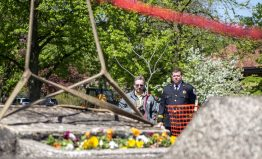 Riverside Public Works Director Edward Bailey (left) and public works Superintendent Kevin Kuratko watch as a crane tries to reassemble the Driver Monument in Guthrie Park on May 13. | Alexa Rogals/Staff Photographer