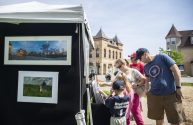 People check out Chris Neumer's breathtaking photos of Riverside and nearby environs at the 12th Annual Riverside Arts Weekend drew families to Guthrie Park in downtown Riverside. | Alexa Rogals/Staff Photographer