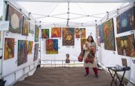 Rashmi Ranganath, whose colorful paintings were quite eye-catching at the 12th Annual Riverside Arts Weekend drew families to Guthrie Park in downtown Riverside. | Alexa Rogals/Staff Photographer | Alexa Rogals/Staff Photographer