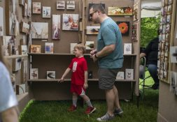 Attendees check out artwork on May 18, during the Riverside Arts Weekend, also known as RAW, at Guthrie Park in Riverside. | Alexa Rogals/Staff Photographer