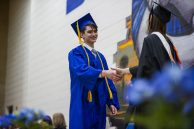 Graduates walk across the stage to receive their diploma on Friday, May 24, during the class of 2019 commencement inside the gymnasium at Riverside Brookfield High School in Riverside. | Alexa Rogals/Staff Photographer