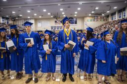 Graduates line back up by their seats after receiving their diplomas during the class of 2019 commencement inside the gymnasium at Riverside Brookfield High School in Riverside. | Alexa Rogals/Staff Photographer
