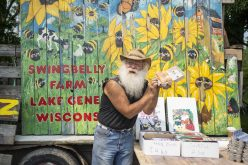 Chuck Barman of Swingbelly Farms in Lake Geneva, Wisconsin, shows off his farm-fresh eggs during the first day of the 2019 farmers market season in Brookfield on June 1. For more info on the Brookfield market as well as the Riverside Farmers Market. | Alexa Rogals/Staff Photographer