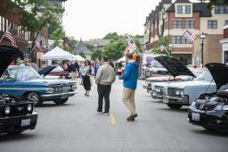 Attendees check out different cars displayed on the street on Thursday, June 20, at the first night of the Cruise Nights event in downtown Riverside, Ill. | ALEXA ROGALS/Staff Photographer