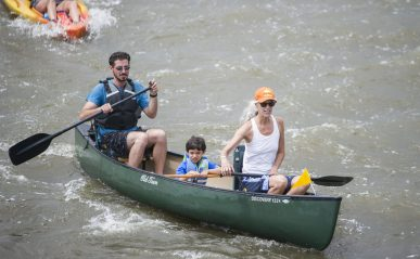 A group of kayakers make their way down the river towards Swan Pond on Saturday, July 6, during the annual Scuff Gross Memorial Kayaking Regatta on the Des Plaines River in Riverside, Ill. (ALEXA ROGALS/Staff Photographer)