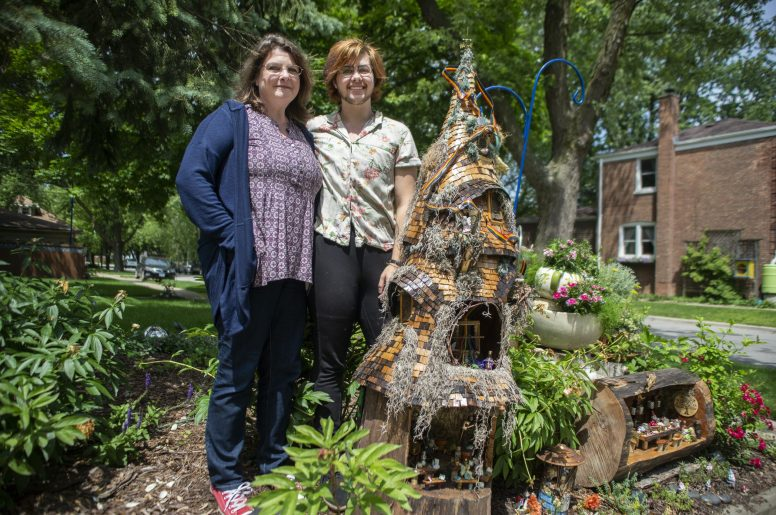 Shirley Trimborn, left, and her son, Connor Trimborn, stand for a photo next to their fairy garden on Saturday, June 22, on Vernon Avenue in Brookfield, Ill. (ALEXA ROGALS/Staff Photographer)