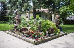 The full fairy garden is seen at the corner of the front yard on Saturday, June 22, on Vernon Avenue in Brookfield, Ill. (ALEXA ROGALS/Staff Photographer)