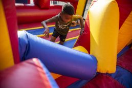 Kids race through the inflatable gym on Saturday, July 27 during the North Riverside village block party in front of Village Commons on Des Plaines Avenue in North Riverside, Ill. (ALEXA ROGALS/Staff Photographer)