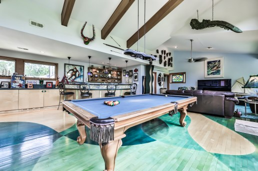 """Waterfront property: The """"Boathouse"""" on Maplewood Road in Riverside has a 280-degree view of the Des Plaines River and forest preserves to the west. Design elements inside the home emphasize its proximity to the water. The owners spent two years working with an architect to realize their vision fusing the 1890s foundation and a contemporary home. (Photos by Johnny Burbano Photography)"""