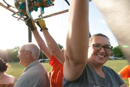Laura Sabak, of Chicago, stands inside the basket holding on before the balloon takeoff on Saturday, Aug. 10, 2019, at Big Ball Park in Riverside, Ill. In Celebration of Riverside's SesquiCentennial they offered tethered Hot Air Balloon Rides to the public. | SHANEL ROMAIN/Contributor