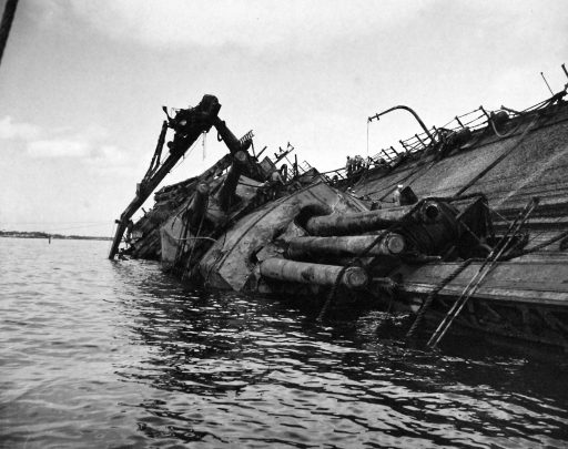 The USS Oklahoma during salvage operations in early 1943 (National Archives)