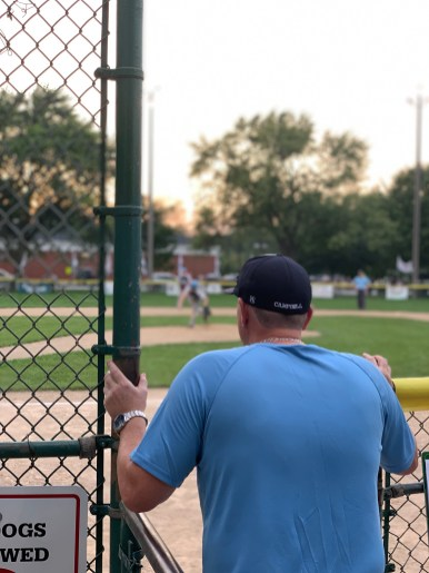 Brookfield's head coach, Dave Campbell, watches as Daniel Lewis delivers a pitch in the first inning of the championship game. | JAMES KAY/Staff