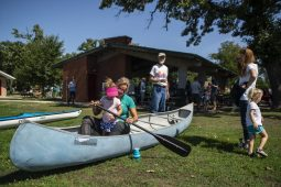 Attendees practice paddling in a canoe on Saturday, Sept. 14, during Meet The Creek event at Kiwanis Park in Brookfield. The canoeing part of the event was cancelled due to high waters.