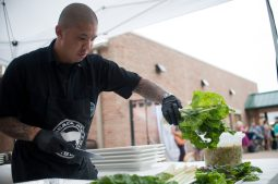 Christopher Chin of Beach Avenue BBQ cuts up Swiss chard at the Brookfield Chamber's Farm to Table event on Sept. 15 at Compassion Factory Art Gallery. (SHANEL ROMAIN/Contributor)
