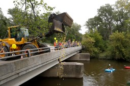 Rubber ducks are dropped from the Washington Ave. bridge Saturday, Sept. 21 for the duck race at the Brookfield Fine Arts Festival.