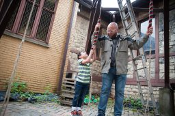 James Baum, who started ringing as a child, shows Billy Boylan, 6, of Brookfield, how easy it is to ring the bells at St. Paul's. Doing it as part of a change ringing group is another story. (Shanel Romain/Contributor)