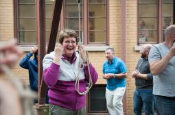 Jenny Heyworth, part of an English tour group traveling all over the eastern United States and Canada to ring bells at more than 20 churches, removes her ear plugs after ringing the bells at St. Paul's in Riverside on Sept. 28. (Shanel Romain/Contributor)
