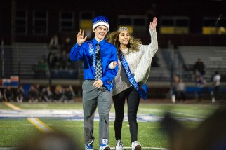 RB's homecoming king, Ryan Gaynor, left, and homecoming queen, Cassandra Hines, both seniors, wave as the crowd cheers them on on Friday, Oct. 4, during the homecoming football game against Ridgewood at Riverside-Brookfield High School. (ALEX ROGALS/Staff Photographer)