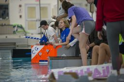 Teams line up their cardboard boats before the race on Oct. 9 during a physics class project in the pool at Riverside Brookfield High School. (Alex Rogals/Staff Photographer)