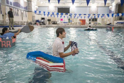 Andrew Lukwinski, a junior, had to swim across the pool and back after his cardboard boat sank on Oct. 9 during a physics class project in the pool at Riverside-Brookfield High School. (Alex Rogals/Staff Photographer)