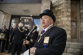 Michael E. Jackson, deputy grand master of the Freemasons' Grand Lodge of Illinois, presided over the rededication of the cornerstone at the Riverside Township Hall on Nov. 3 in honor of that event's 125th anniversary this month. (Alex Rogals/Staff Photographer)
