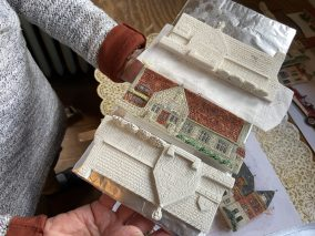 The raw building replicas -- the Riverside Public Library is shown here -- are baked in McCarthy's oven and let to dry before she paints them. (Bob Uphues/editor)