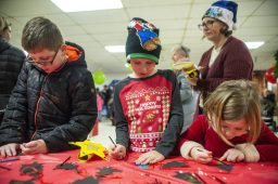 From left, Matthew Thompson, 9, Henry Thompson, 7, and Caroline Thompson, 5, all of Brookfield, decorate ornaments in the basement of Brookfield Village Hall on Dec. 7 during the annual holiday celebration in Brookfield.