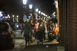 Crowds meander down East Burlington Street in Riverside during the Holiday Stroll on Dec. 6, visiting businesses and soaking up holiday cheer.