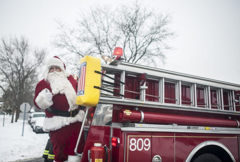 Santa rides through North Riverside via fire truck on Dec. 21, beginning at 9:05 a.m.