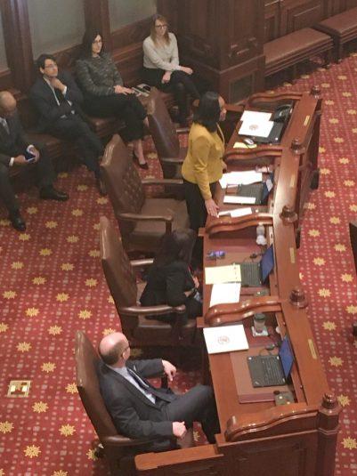 State Senator Kimberly Lightford rose Sunday to nominate Don Harmon [foreground] as state Senate president.   (Photo by Bob Skolnik