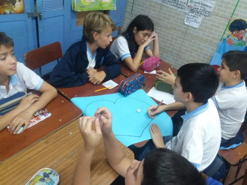 After initially adjusting, Hauser seventh-grader Chase Zidlicky (top row, middle) settled right in with his classmates at a school in Concepcion, Paraguay, where he studied all of the fall 2019 semester.