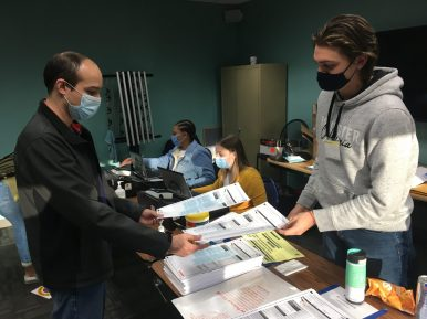 Ethan Bork, right, a 17-year-old North Riverside resident made his debut on Nov. 3 as an election judge at the North Riverside Village Commons. He was one of several teens not yet old enough to vote who worked last week's election. (BOB SKOLNIK/Contributing Reporter)