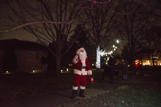 Santa waves to residents from the Fitzgerald's holiday bus on Dec. 10, in Riverside. (Alex Rogals/Staff Photographer)