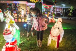 Maggie and Carolina Rotolo, of Clarendon Hills, came by to visit Santa and his elves and wander among the lighted decorations. (Alex Rogals/Staff Photographer)