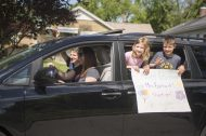 Families of present and past students -- about 50 of them -- said farewell to Jenny Barhorst personally during a drive-by parade outside Hollywood School on May 29. (Alex Rogals/Staff Photographer)