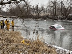 No one was inside this maroon Ford sedan when it was found half submerged in the Des Plaines River on the morning of Jan. 24. That afternoon, however, first responders located the body of a woman they believe was the driver about 500 yards downstream from the car. (Bob Uphues/Editor)