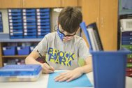 Brook Park School fifth-grader Tristan Spaargaren works on a project in class on the first day of hybrid-learning school on Aug. 26. (Alex Rogals/Staff Photographer)