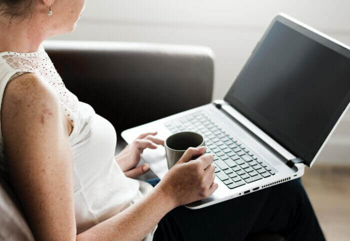 Hypnotherapy Online, woman using laptop